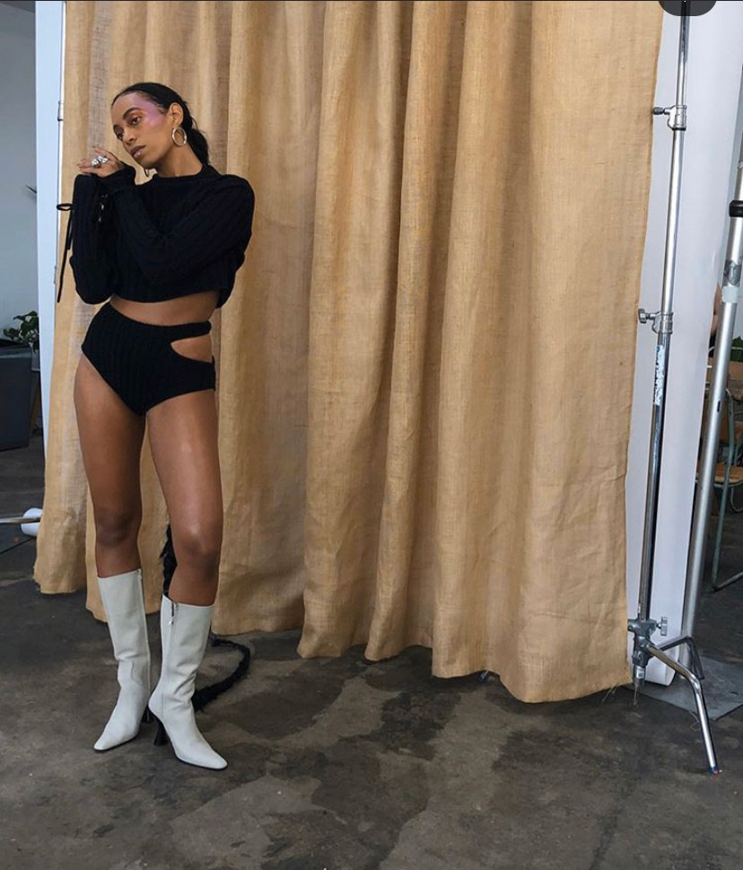 Solange wearing Stainless Boots